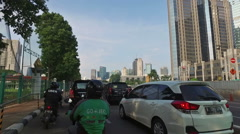 Driver pov of a traffic jam in Jakarta crowded street in Indonesia capital city. Stock Footage
