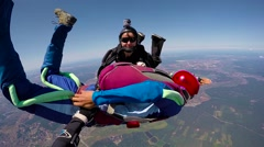 Skydiver in free fall opening parachute, editorial Stock Footage