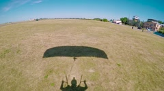 Shadow of landing skydiver Stock Footage