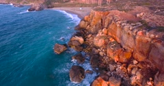Beautiful seashore with clifs at sunset Stock Footage