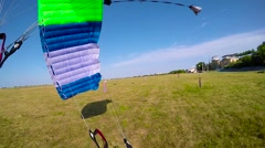 Skydiver landing on parachute Stock Footage