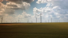 Clean and renewable energy on golden wheat field and cloudy sky tilt up 4k UHD Stock Footage