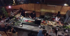 4k - people dine at a sushi bar Stock Footage