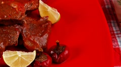 Roasted beef meat on red plate with asparagus Stock Footage