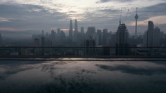 Timelapse of Kuala Lumpur, city view from rooftop pool Stock Footage