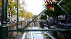 Tour boat sails in Amsterdam canal, Holland, Netherlands - view from canal Stock Footage