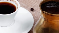 Black Turkish coffee in small white mug with coffee beans Stock Footage