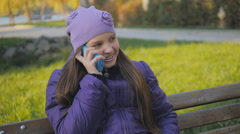 Cute teen girl smiling talking on the phone. dental braces. slow-motion Stock Footage