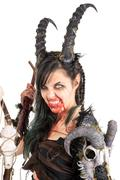 Faun sorceress with big horns and blood isolated in white Kuvituskuvat