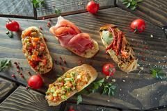 Assorted Italian appetizer bruschetta Stock Photos