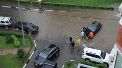 ODINTSOVO, RUSSIA - People are trying to save car from the water Stock Footage