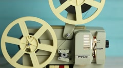 Retro film projector on a blue wooden background Stock Footage