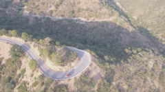 U-shape curve and 4x4 vehicle aerial view at dusk Stock Footage