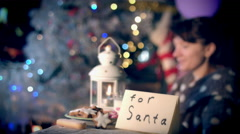 4k Christmas and New Year Holiday Woman Putting Letter for Santa and Cookies Stock Footage