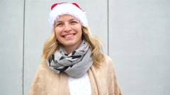 Young woman with Christmas cap Stock Footage