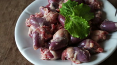 Fresh raw chicken hearts Stock Footage