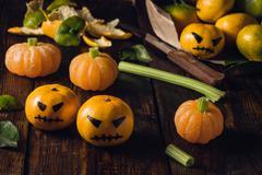 Tangerine Halloween with fake pumpkins Stock Photos