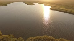 Sunset Lake With Sun reflecting in it Stock Footage