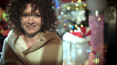 4k Christmas and New Year Holiday Woman Smiling on Fireplace Background Stock Footage