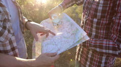Two Tourists on a Trip, Use Map and Compass Stock Footage