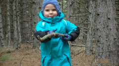 Small boy with big stick in forest Stock Footage