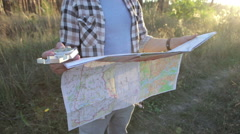 Man is Traveling, Uses a Map and Compass Stock Footage