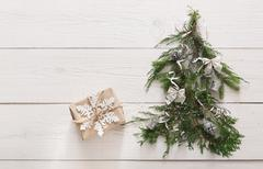 Christmas background. Gift boxes on fir tree at white wood Kuvituskuvat