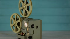 Movie projector with the film on the wooden floor Stock Footage