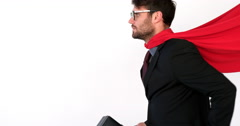 Businessman pretending to be a super hero Stock Footage