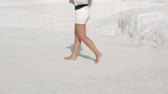 Active tourist girl walking through the historical site of Pamukkale Stock Footage