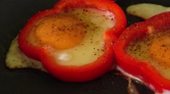 Making omelet fried egg  in red sweet pepper ring Stock Footage