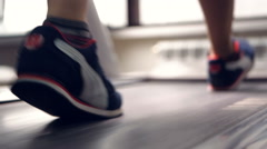 Female legs walking and running on treadmill in gym. Healthy lifestyle concept Stock Footage
