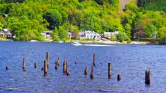 Speed boats enjoying the summer sunshine on Loch Earn, Scotland, UK Stock Footage