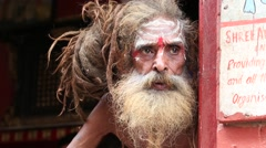 Portrait of Shaiva sadhu, holy man in Pashupatinath Temple, Nepal Stock Footage