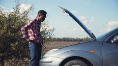 Unsuccessful car fixing Stock Footage