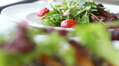 Ruccola salad and vegetable sushi restaurant plate Stock Footage