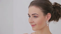 Portrait of pretty, sensual woman with beautiful make-up and elegant hairstyle Stock Footage