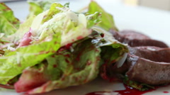 Meat and fresh salad dish Stock Footage