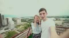 Couple in love on the roof. Girl with eyes closed Stock Footage