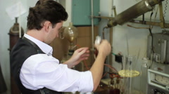 Scientist looks at reagents in laboratory for experiments Stock Footage