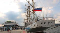 People walking around sailboats in port of Varna. Black Sea Tall Ships Regatta Stock Footage
