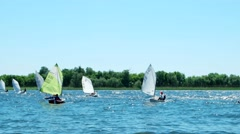 Competition, teens, children participate in a sailing regatta, sports on water Stock Footage