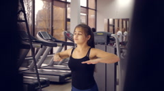 Beautiful asian ethic sporty female doing sports exercise workout in a gym Stock Footage