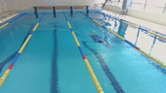 Professional woman swimmer training in swimming pool. Aerial view Stock Footage