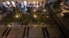 Timelapse of people on central city square at night, Thessaloniki Stock Footage