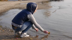 Girl runs the leaf in the water Stock Footage