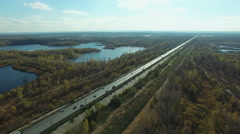 Aerial footage of road and  people traveling by cars on a highway Stock Footage