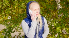 Girl talking on the phone Stock Footage