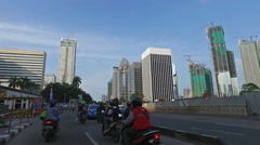 POV of a motorcycle in the streets of Jakarta city Stock Footage