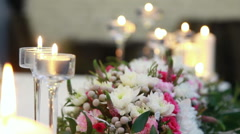 Beautiful flower decorations on tables at reception Stock Footage